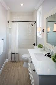 wood tile flooring in bathroom. Guest Bathroom With Wood Grain Tile Floor Subway In The Shower Bathrooms Floors Flooring