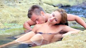 loving couple kissing at the sea s
