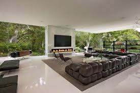 Contemporary Living Room with Neutral area rug, Glass wall, Frameless  corner window, Frameless