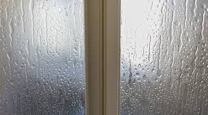 how to remove hard water spots from glass shower doors