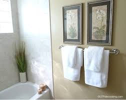 hanging towel. Create A Focal Point In Your Bathroom By Hanging Pictures Above Towel Rack