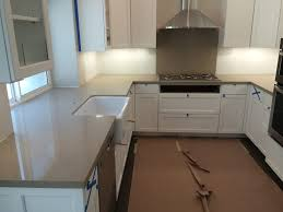 quartz counters with 1 1 2 mitered edge and farm sink cutout all one piece backsplash behind cooktop 36 x 32 yelp