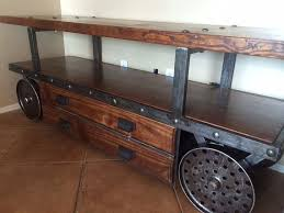 iron industrial furniture. vintage industrial tv console with salvaged bowling alley wood and cast iron wheels furniture