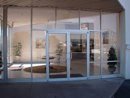 double glass front doors with white alumunium frames and stainless steel handle connected by