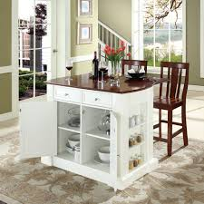 white portable kitchen island. Choose Wooden Stools And White Movable Kitchen Island On Artistic Carpet Near Green Painted Wall Portable L