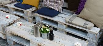 diy wood pallet patio furniture with colorful cushions and storage space