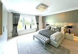 chandelier in bedroom over bed modern chandeliers for high ceilings purple crystal fan