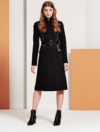 if you want to keep the classic shape but with a slight rock chic edge then this elegant black coat with its leather detail and buckle and belted finish is