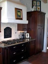 i love this spanish revival kitchen with the red tiles the blue