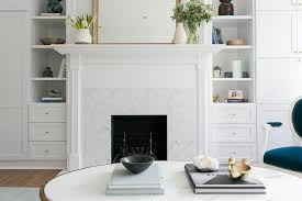 white fireplace mantel with white marble herringbone tiles