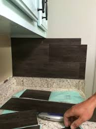 Vinyl Floor Tile Backsplash Our 40 Backsplash Using Vinyl Flooring Re Fabbed