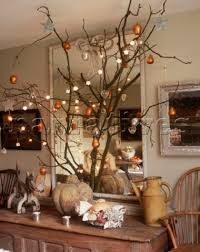 Christmas decorations on branch in front of mirror