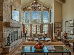 Interior Decoration : Classic Living Room With Brown Sofa Under Vintage  Chandelier On Cathedral Ceiling Also Stone Rustic Fireplace And Clear Glass  Table ...