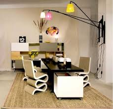 office at home. small home office with funky chairs and colorful lamps at n