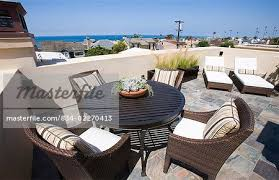Image Build In Bench Patio Furniture On Rooftop Deck With Ocean View Stock Photo Masterfile Patio Furniture On Rooftop Deck With Ocean View Stock Photo