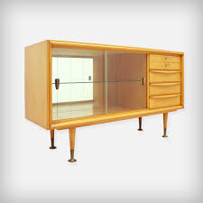 small cherrywood sideboard with glass doors and brass details 1950s