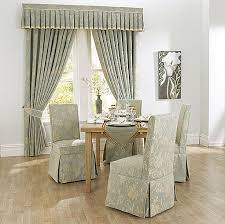 charming slipcovers for dining room chairs with patterned fabrics bined with impressive window treatmet in the
