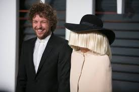 sia r and erik anders lang arrive to the 2016 vanity fair oscar party