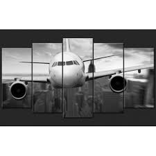 modern black and white wall décor pentaptych aircraft above manhattan