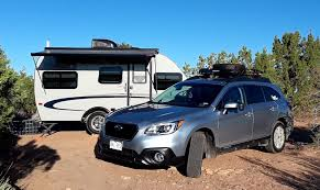 subaru outback towing a cing trailer rv cross country
