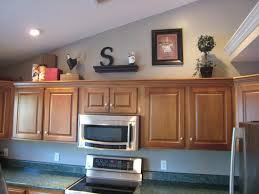 ideas for decorating top of kitchen cabinets