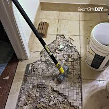 guest bathroom 7 diy hex tile floor removing two layers of tile with a sledge hammer