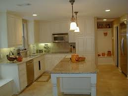 white painted kitchen with speckled granite countertops