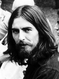 George Harrison Singer with the Beatles Pop Group with Long Hair and Beard. c.1969 - Photographic Print - Q55BF00Z