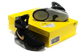 black and gold nike mag shoes from back