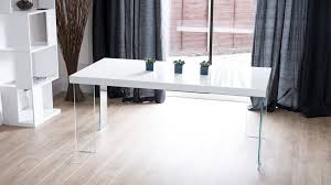 glass legged white gloss dining table