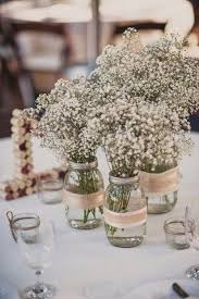 Picture Of a combo of three mason jars wrapped with burlap and with baby's  breath