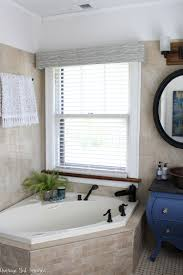 A dated master bathroom gets a light and bright makeover in tones of blue  and gold