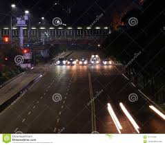 Stop Light At Night Cars Stop At Traffic Light At Night Stock Image Image Of
