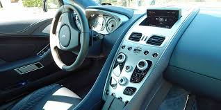 aston martin rapide 2015 interior. the interior serious in its exotic sports car intent with proper gauges and high aston martin rapide 2015
