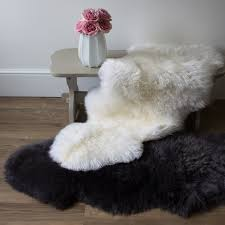 double sheepskin rugs with a luxurious deep pile in slate grey and ivory