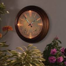 illuminated outdoor wall clock google