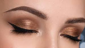 for this makeup at first you will need a primer concealer dark brown eyeshadow bronze eyeshadow eyeliner gold eyeliner and a mascara