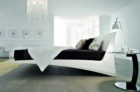 View in gallery Exquisite floating bed with interesting form