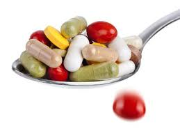 Image result for images of vitamin pills on spoons