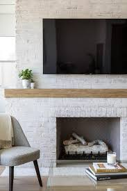 white painted brick fireplace with flat panel tv