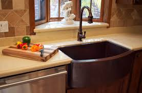 copper farmhouse sink and matching faucet