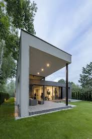 A Shaped House Design L Shaped Family Home Exhibiting A Distinctive Roof And