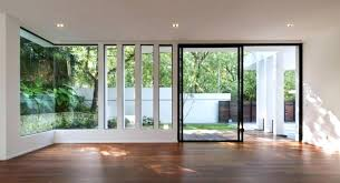 bright large hall with wooden flooring and glass sliding door decorated by recessed lamps idea flush pull handle