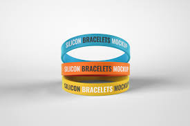These mockups could be used for brand recolonization by altering or inserting company brand name and logo. Silicone Rubber Bracelet Mockup In Product Mockups On Yellow Images Creative Store