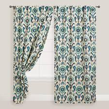featuring our exclusive global inspired design these enchanting indigo and ivory curtains create tab top