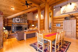 vaulted ceilings in log home living room with massive slate rock fireplace and 18 cedar