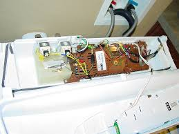 small leak drip fisher paykel gwl washer pictures cold is the left valve the yellow body the little wired device at front of the mixing chamber is the thermistor to sense water temperature