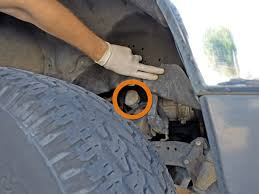 1989 1994 toyota pickup oil change 2 4l i4 1989 1990 1991 image 1 3 lift the mud flaps to reveal the location of the oil