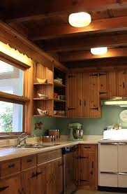 painting knotty pine kitchen cabinets painting knotty pine cabinets black painting knotty pine cabinets before and