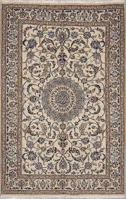 nain rugs are generally cream tan light blue and navy blue colored including accents of red